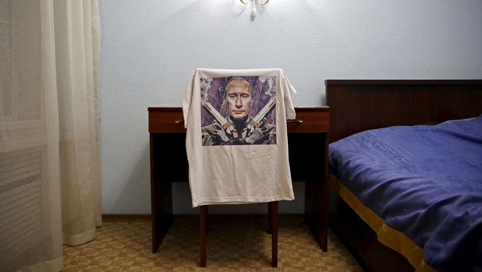 A T-shirt depicting Vladimir Putin: Russia is only as strong as the West is weak.