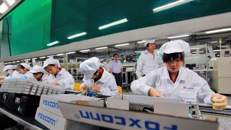 Produktion beim Elektronik-Fertiger Foxconn: Wegen schlechter Arbeitsbedingungen in der Kritik