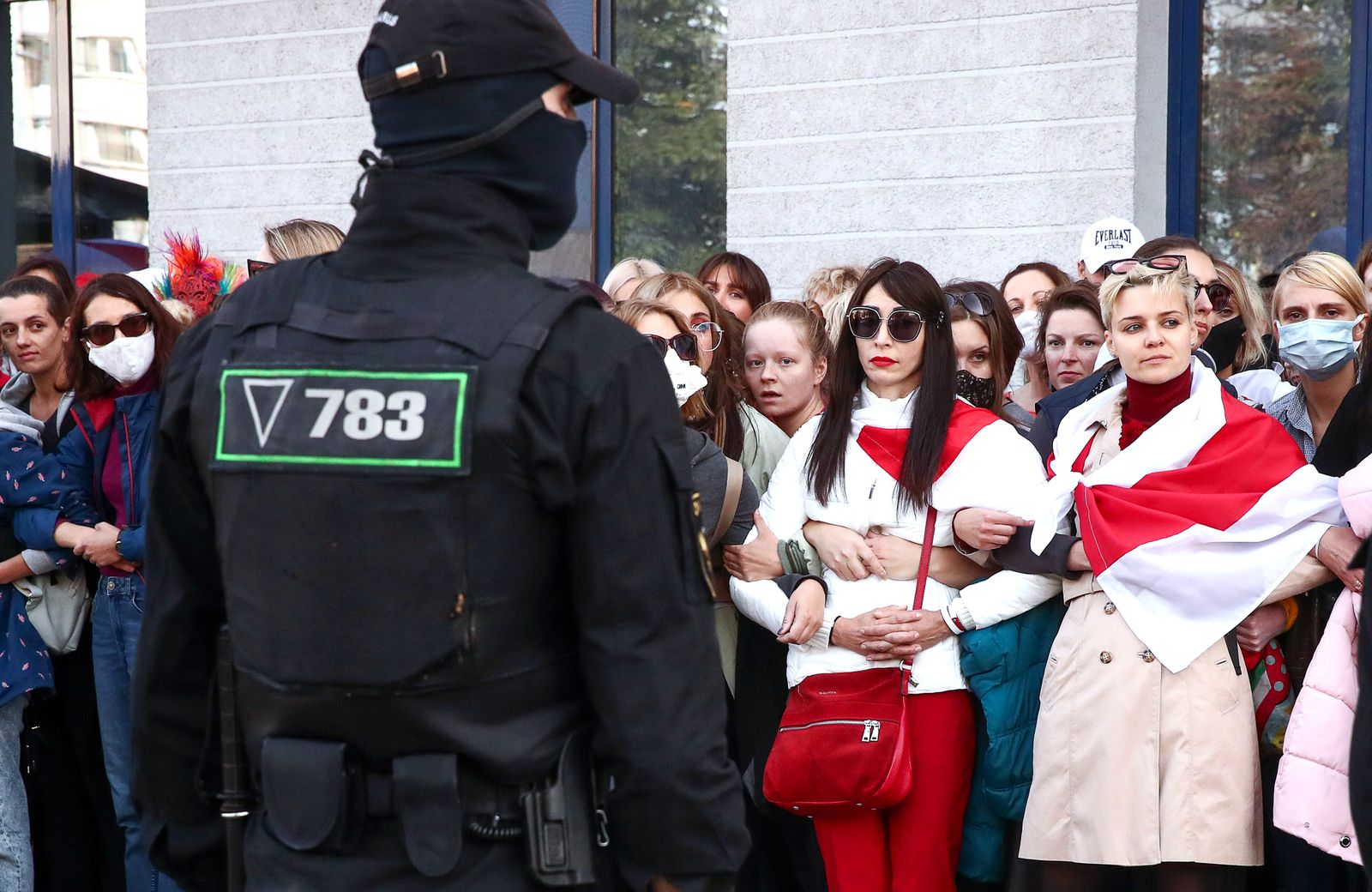 MINSK, BELARUS SEPTEMBER 19, 2020: A law enforcement officers observes participants in the Bright March for Women s S