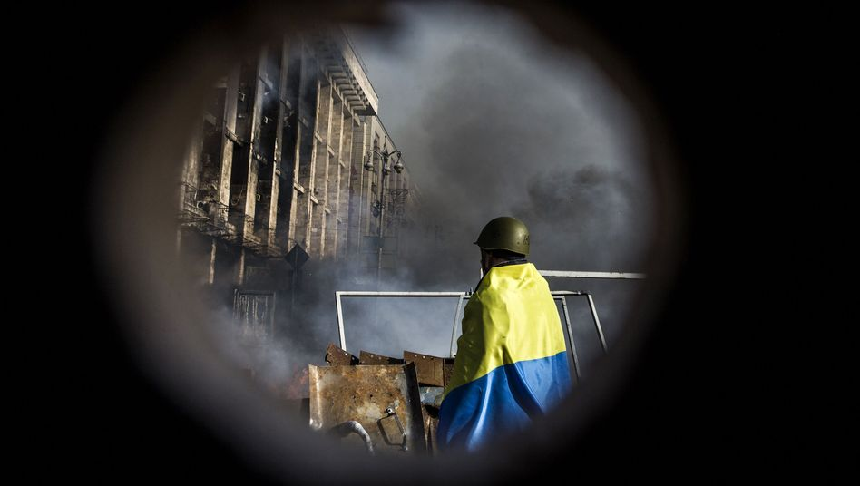 An anti-government protester in Kiev at a barricade in the center of the city on Wednesday evening.