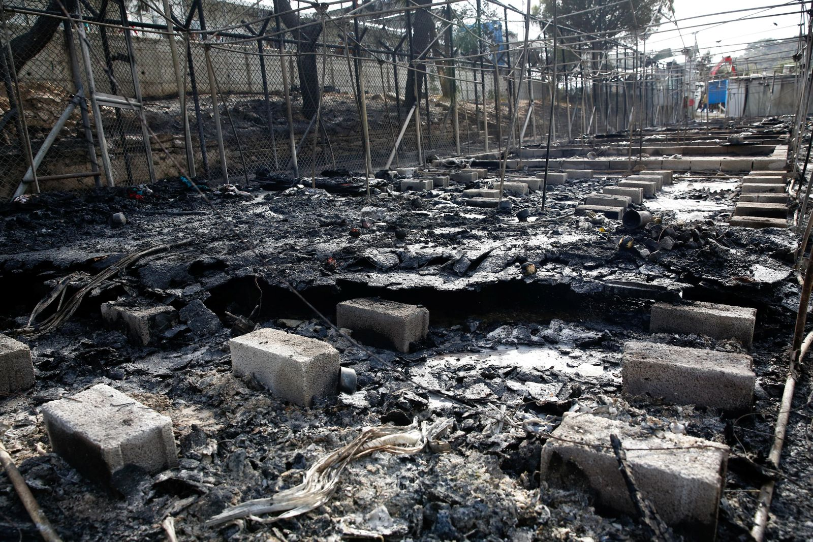 The remains of a burned tent at the Moria migrant camp, after a fire that ripped through tents and destroyed containers during violence among residents, on the island of Lesbos