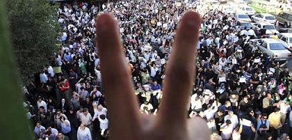 A protester gestures during a demonstration against President Mahmoud Ahmadinejad around Haft-e Tir square in Tehran on Thursday.