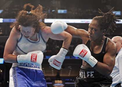 Anne Wolfe, right, lands a punch on Marsha Valley in their June 18 fight. Next up for Wolfe: Bo Skipper.