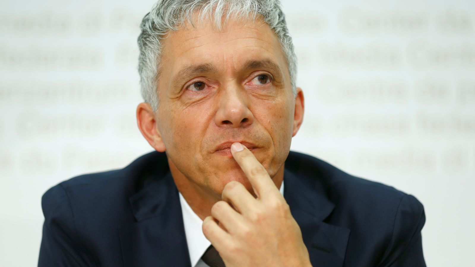 FILE PHOTO: Swiss Attorney General Lauber listens to a question during news conference in Bern