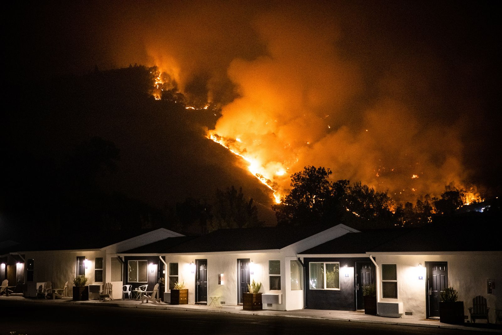The Glass Fire burns above Calistoga, Calif, near residences early Tuesday, Sept. 29, 2020. (Max Whittaker/The New York Times)