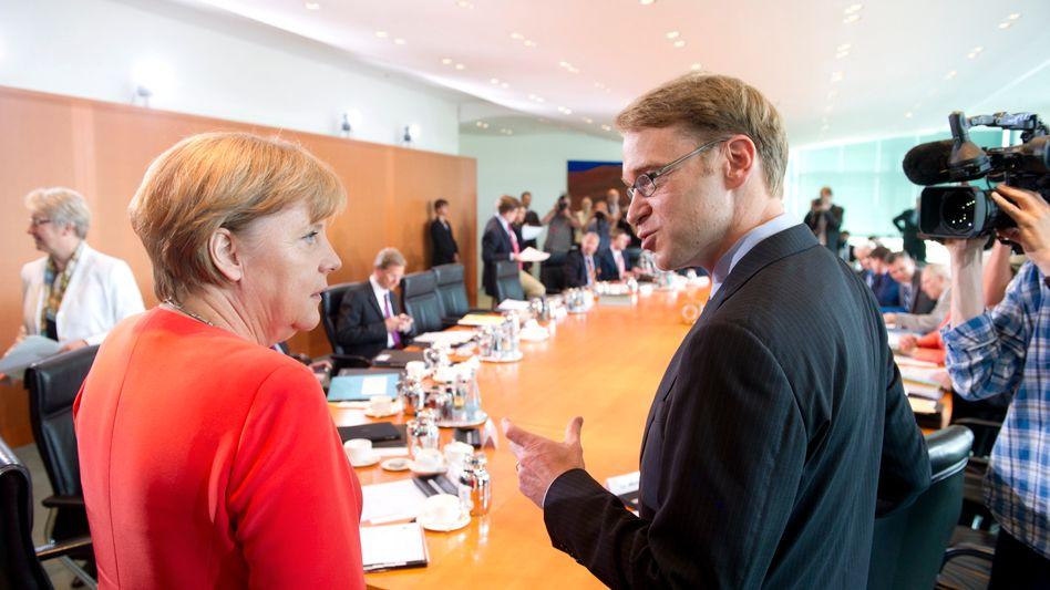 Kanzlerin Merkel, Bundesbank-Chef Weidmann: Belehrung vom ehemaligen Berater
