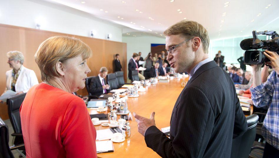 Bundeskanzlerin Merkel, Bundesbank-Präsident Weidmann: In die Parade gefahren