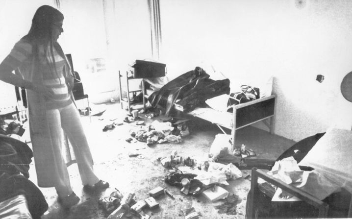 In this archive photo, Ankie Spitzer, the widow of murdered fencing coach André Spitzer, is seen viewing the devastated apartment of the Israeli athletes in the Munich Olympic Village on Sept. 9, 1972.