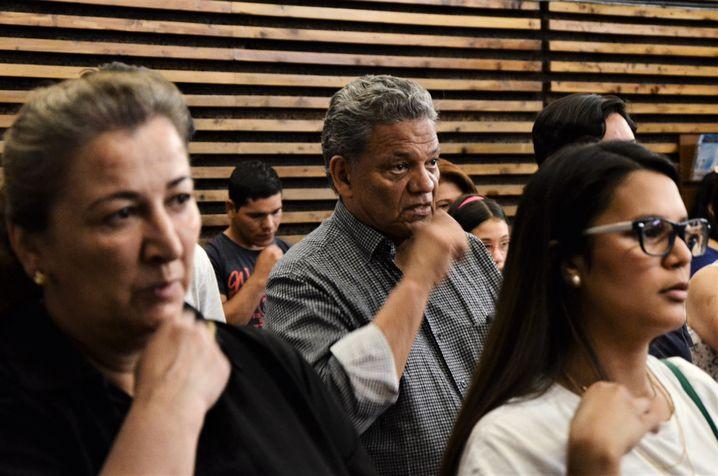 Erick Zuleta attends a church service in Madrid.