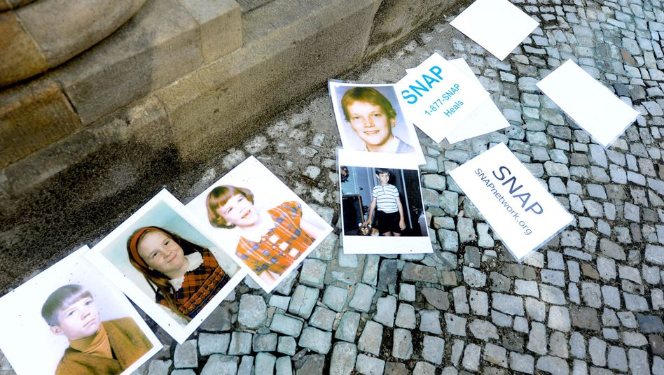 Images of abuse victims displayed on Wednesday in Berlin by the victims' group SNAP.