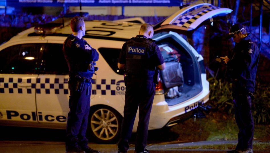 Ermittler der Polizei Melbourne nach Beendigung des Geiseldramas