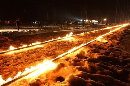 The railway tracks of the Auschwitz concentration camp are illuminated with fire in memory of the victims of the Holocaust.