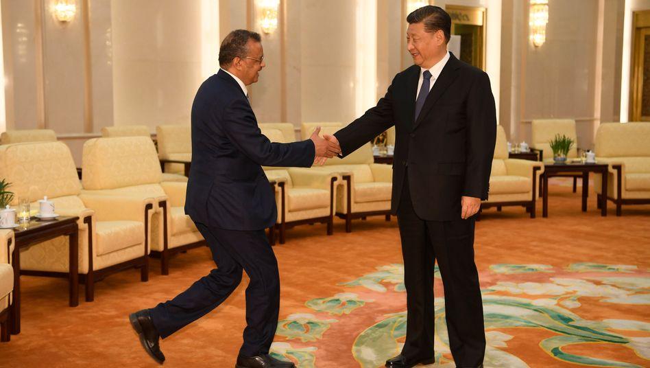 Tedros Adhanom Ghebreyesus, Generaldirektor der WHO, und Chinas Präsident Xi Jinping: Keine Schwäche zeigen