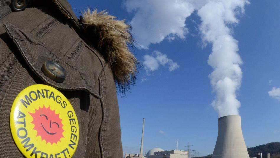 A German anti-nuclear protester stands near an atomic power plant in Bavaria on Monday.