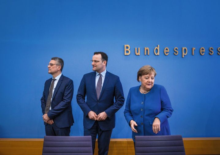 Robert Koch Institute President Lothar Wieler, German Health Minister Jens Spahn and Chancellor Angela Merkel at a coronavirus press conference in Berlin
