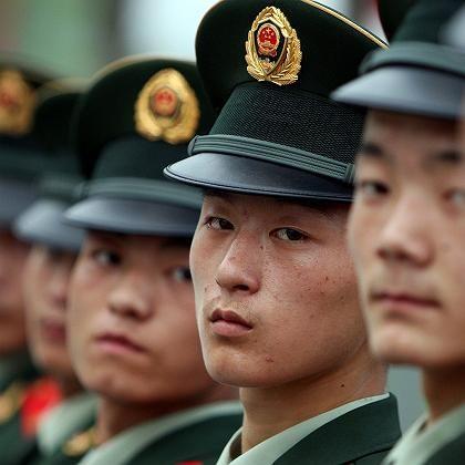 Chinesische Sicherheitsleute: Sie sollen jetzt noch mehr Kontrollen vornehmen