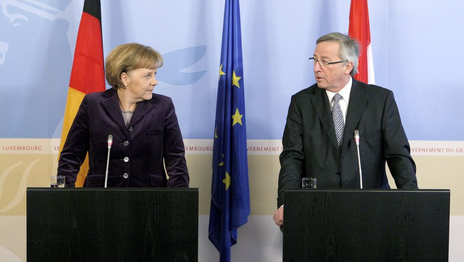 German Chancellor Angela Merkel (L) and Luxembourg's Prime Minister Jean-Claude Juncker, Chairman of the Eurogroup, at a joint news conference in Luxembourg in March.