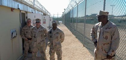 """Guards stand at the Guantanamo Bay prison facility: """"We will need your help."""""""