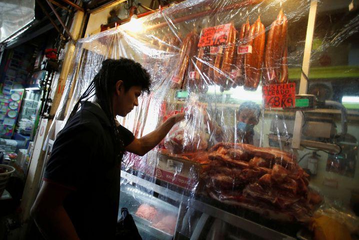 Auf Lateinamerikas Märkten geht das Geschäft trotz Ansteckungsrisiko weiter