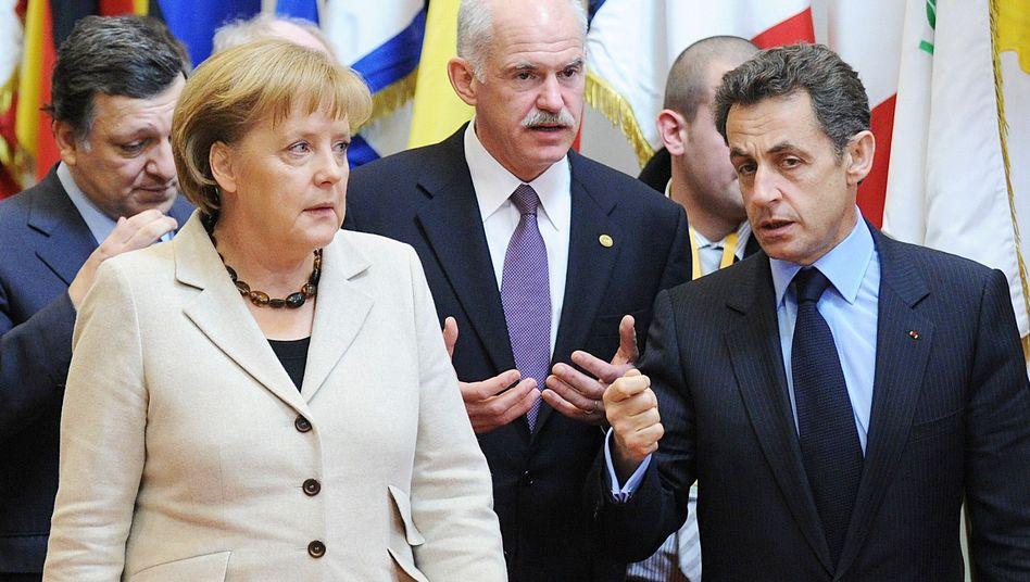 European Commission President Jose Manuel Barroso, German Chancellor Angela Merkel, Greek Prime Minister George A. Papandreou, French President Nicolas Sarkozy.