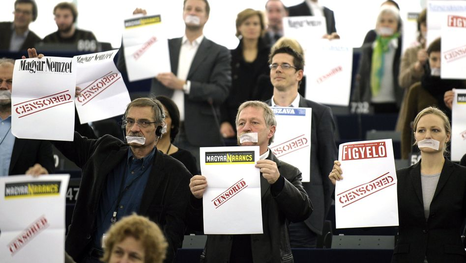 Green Party members of the European Parliament protested during the Hungarian Prime Minister Viktor Orbán's speech to the European Parliament on Wednesday.