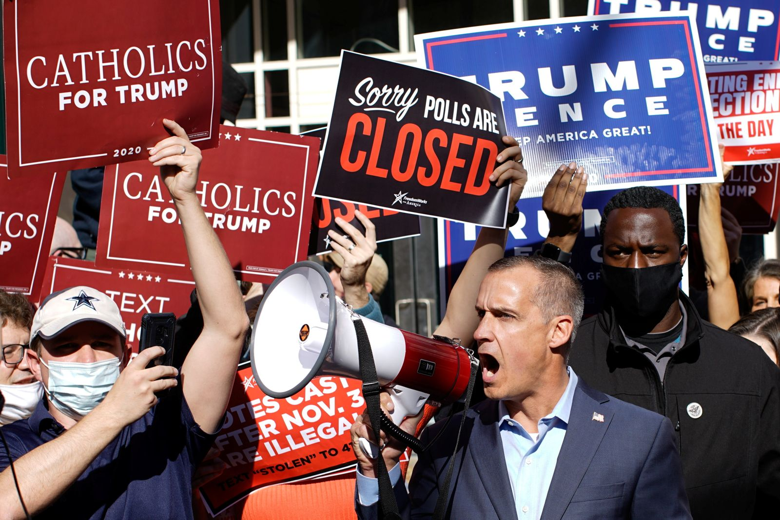 Former campaign senior adviser Of U.S. president Donald Trump, Corey Lewandowski uses a megaphone as supporters of U.S. president Donald Trump rally as votes continue to be counted following the 2020 U.S. presidential election, in Philadelphia
