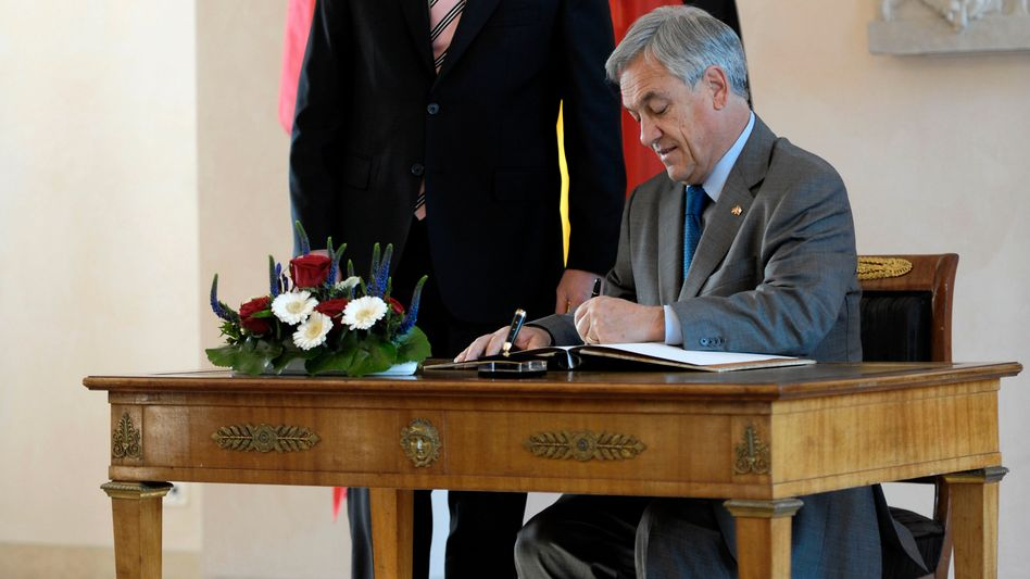 """""""Deutschland Über Alles:"""" Chilean President Sebastian Pinera wrote his controversial dedication into the official guest book of German President Christian Wulff (left)."""