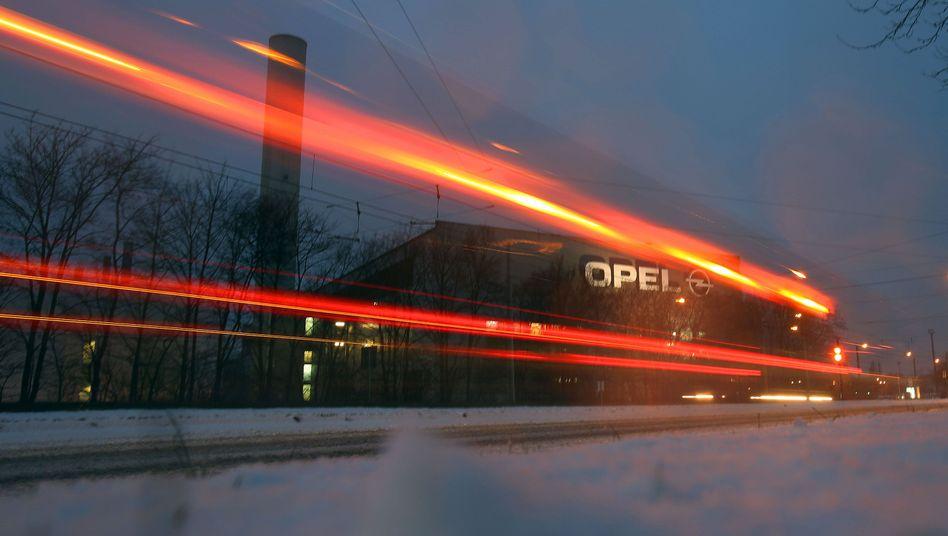 A car passing Opel's plant in Bochum.