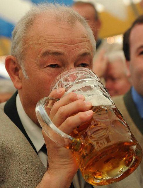 Bavarian Governor Günther Beckstein enjoys a liter Mass of beer.