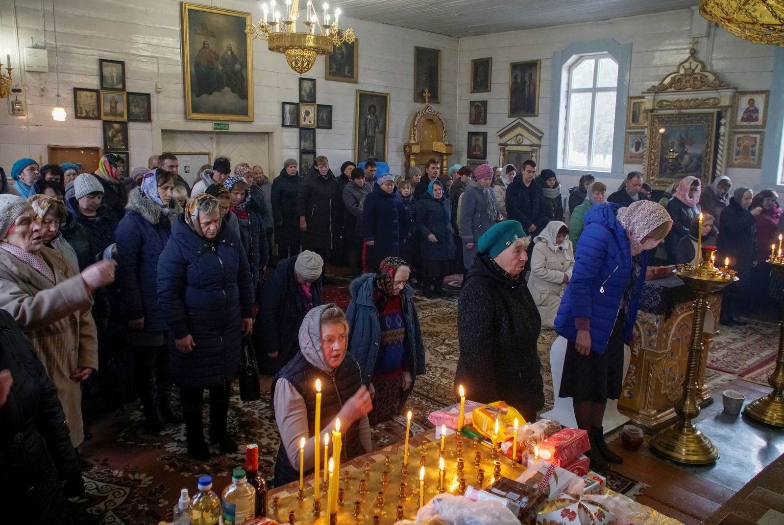 People attend a service in an Orthodox Church in Dyatlovo