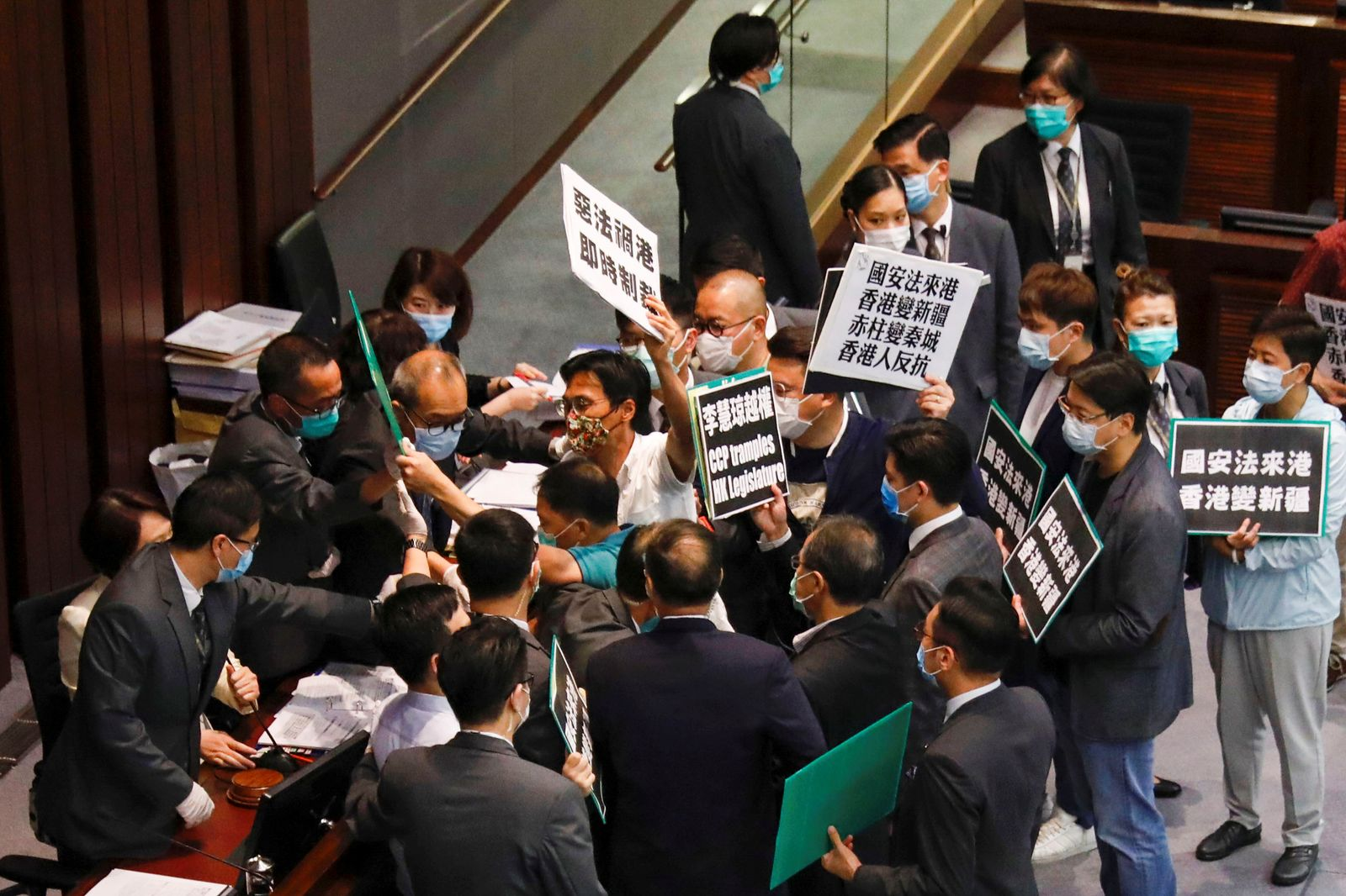 Pan-democratic legislators scuffle with security as they protest against new security laws during Legislative Council?s House Committee meeting, in Hong Kong