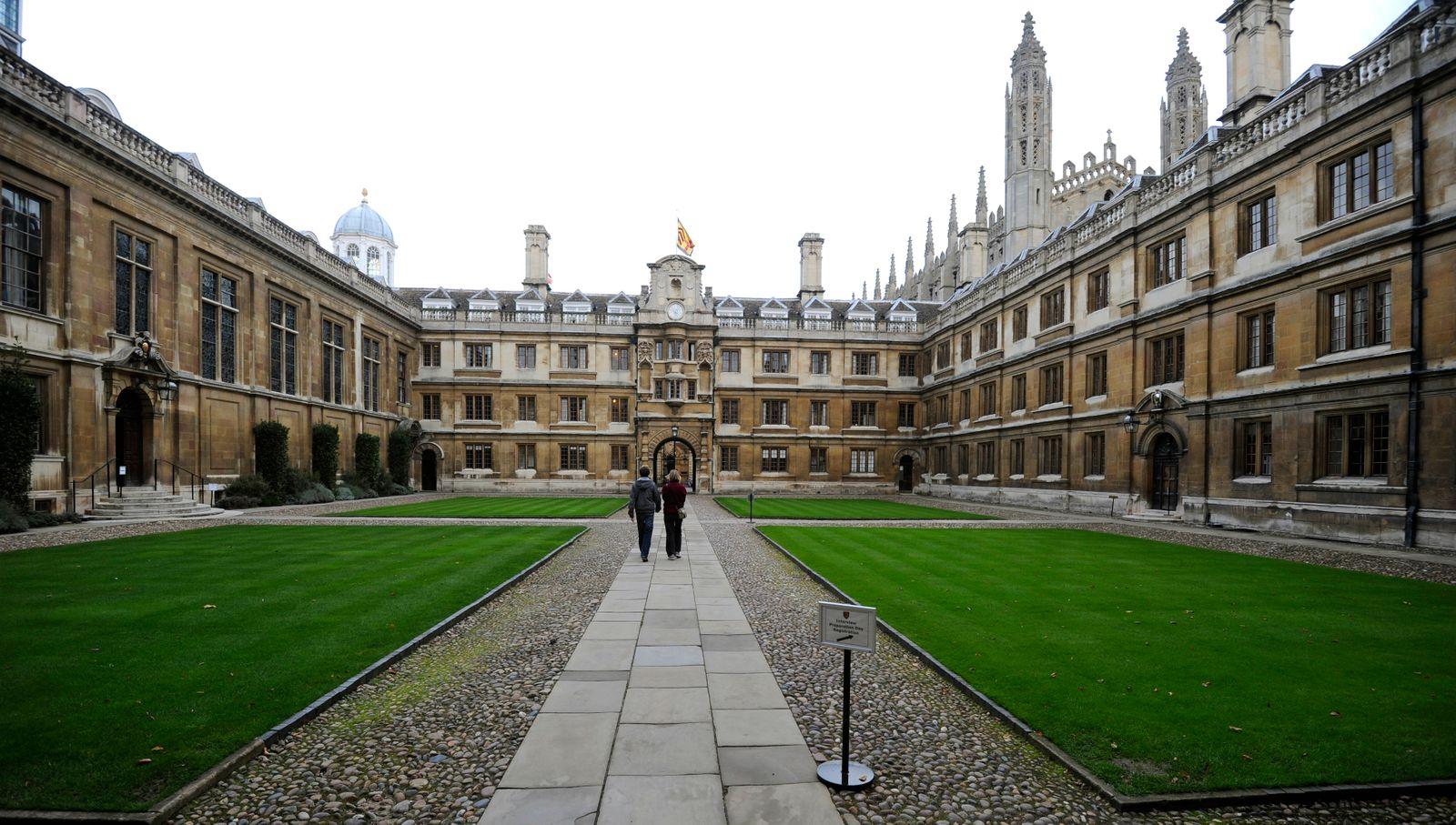 People walk through Clare College at Cambridge University