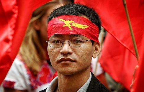 A protester outside the Burmese embassy in London marks the 20th anniversary of the 1988 uprising.