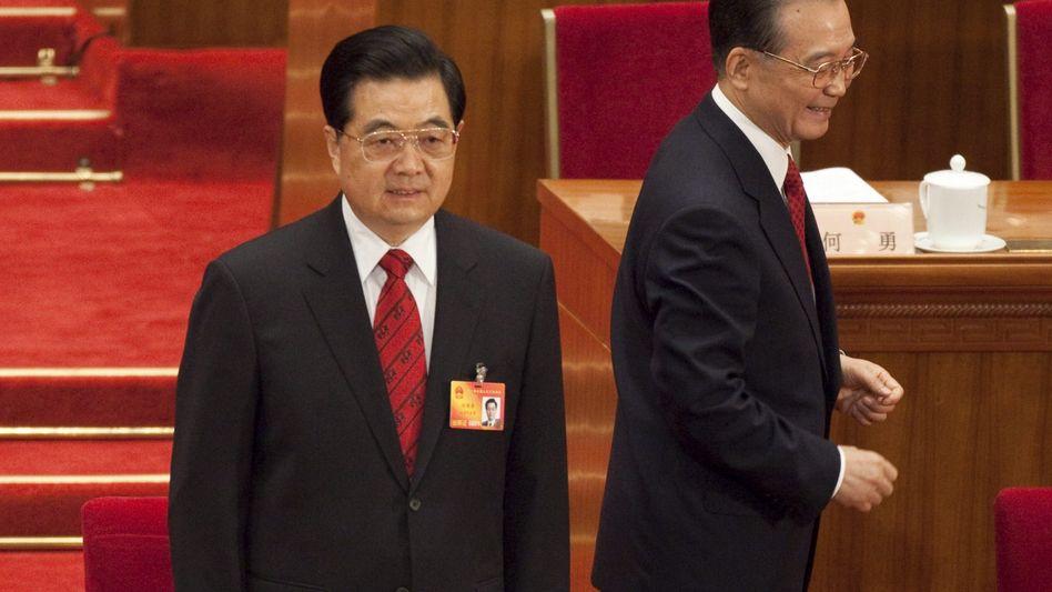 Premier Wen Jiabao (R), Präsident Hu Jintao: Haushaltsdefizit soll 100 Milliarden erreichen