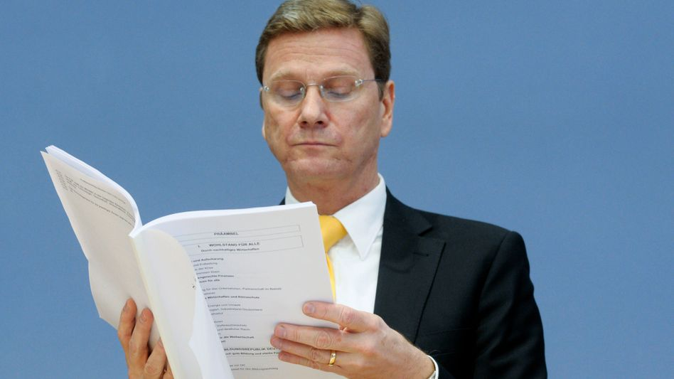 The new foreign minister looks confused: Is this document in English? Guido Westerwelle's linguistic back-and-forth with a BBC reporter continues to have humorous repercussions.