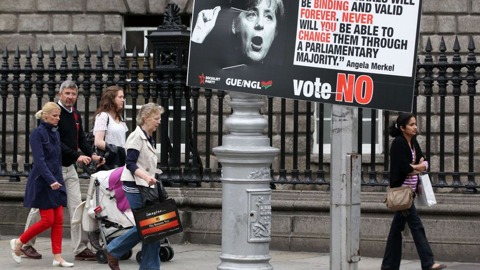 Scaremongering with Merkel: People pass an anti-fiscal pact placard in Dublin.