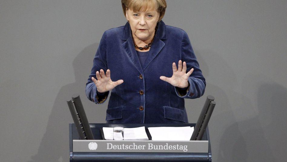 Angela Merkel addressing the German parliament on Wednesday.
