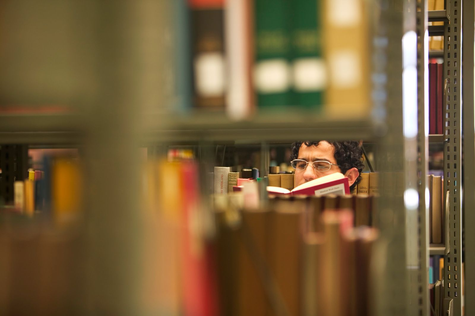 Man Behind Library Bookcases