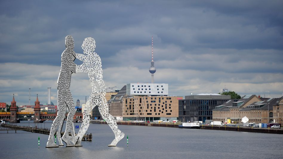 """A view of Berlin's skyline including the """"Molecular Man"""" sculpture. Now the city's tech scene is fighting back against the copycats."""