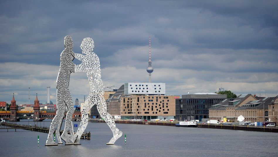 "A view of Berlin's skyline including the ""Molecular Man"" sculpture. Now the city's tech scene is fighting back against the copycats."