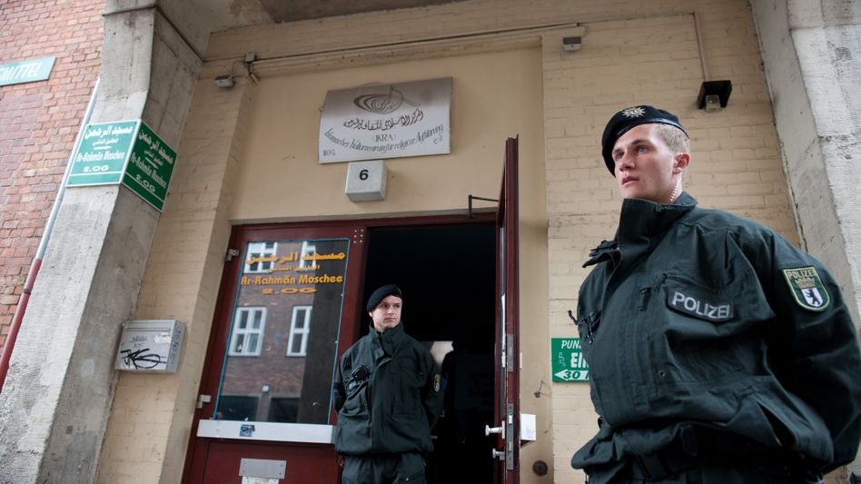 Berlin police outside an Islamic cultural center in Berlin's Wedding district.