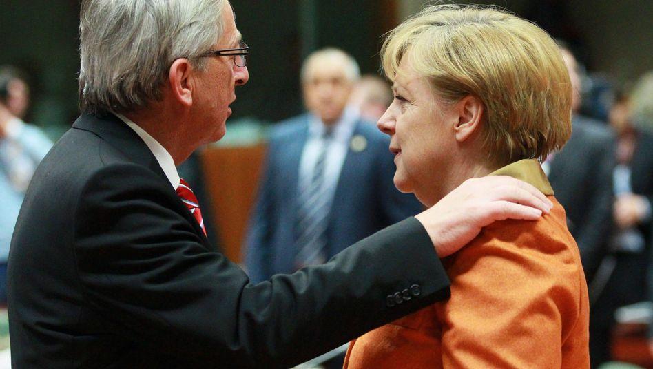 Jean-Claude Juncker, Angela Merkel (Archiv): Spannung vor der Europawahl