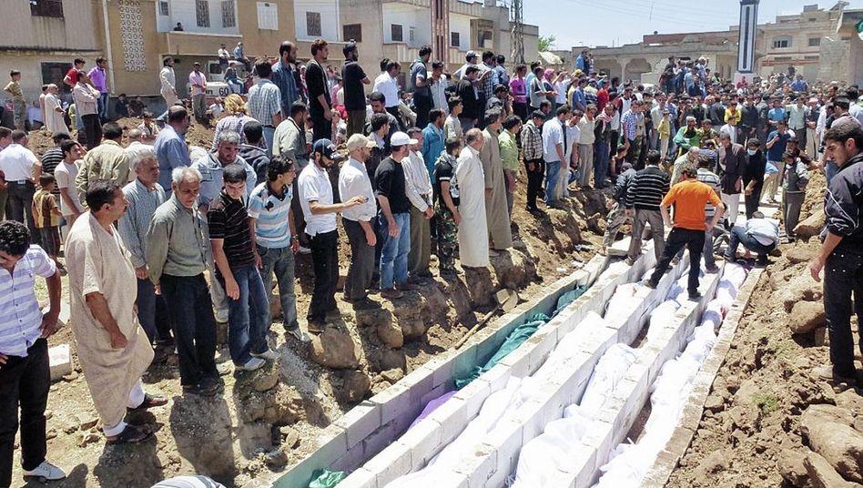 Massengrab in Hula: 60 bis 70 Männer in Uniform marschierten auf das Dorf zu