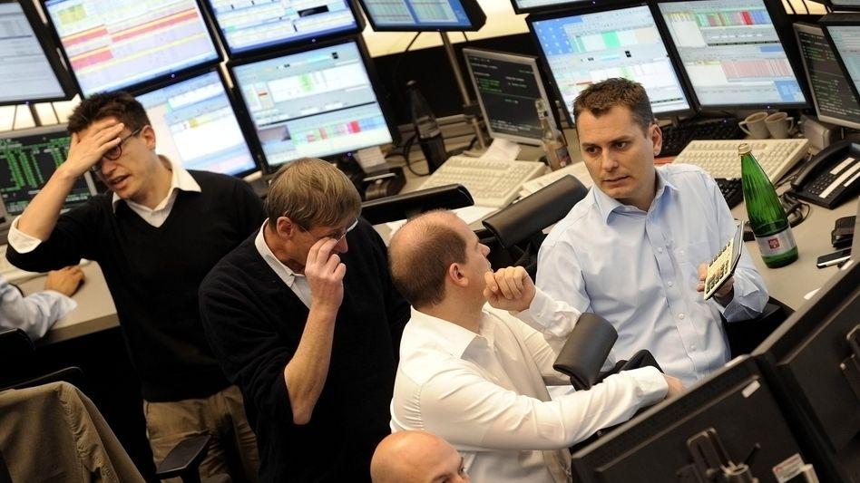 Traders working at the German stock exchange in Frankfurt am Main.