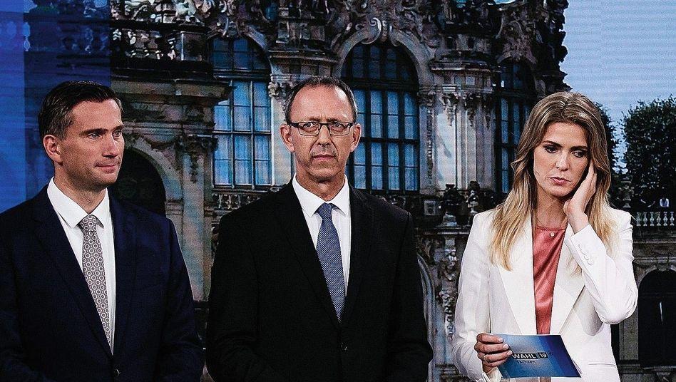 MDR-Moderatorin Wiebke Binder mit den Politikern Martin Dulig von der SPD (links) und Jörg Urban von der AfD.