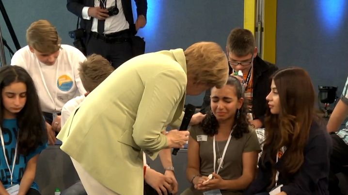 Merkel tries to comfort Reem Sahwil at a town meeting in Rostock on July 15, 2015.