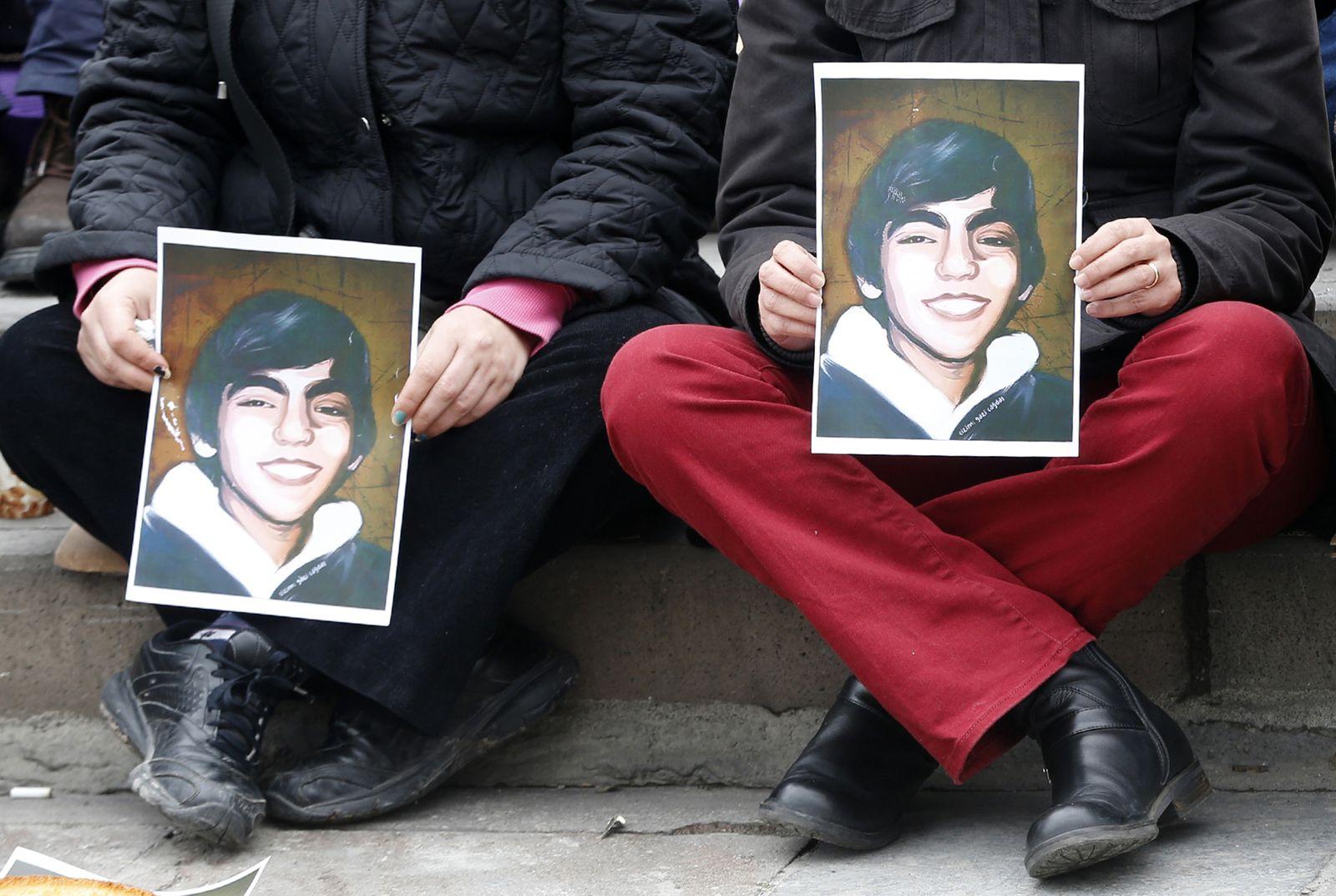 People hold portraits of Berkin Elvan during a sit-in demonstration in Ankara