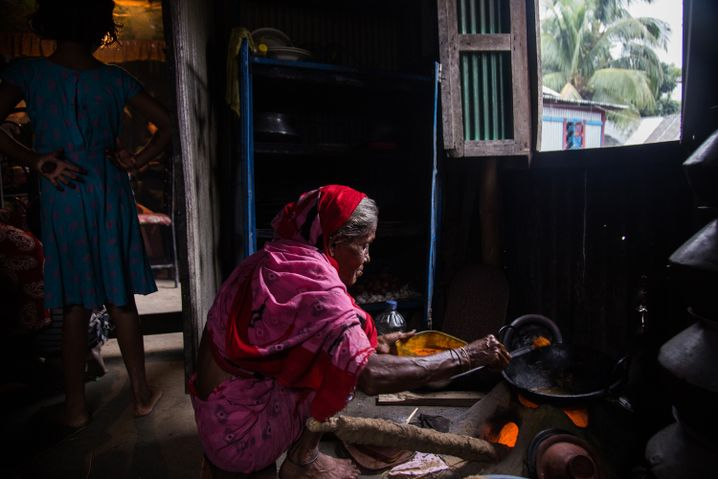 Tasnia Begum's mother, Jamena, cooks in the kitchen the day after Eid.