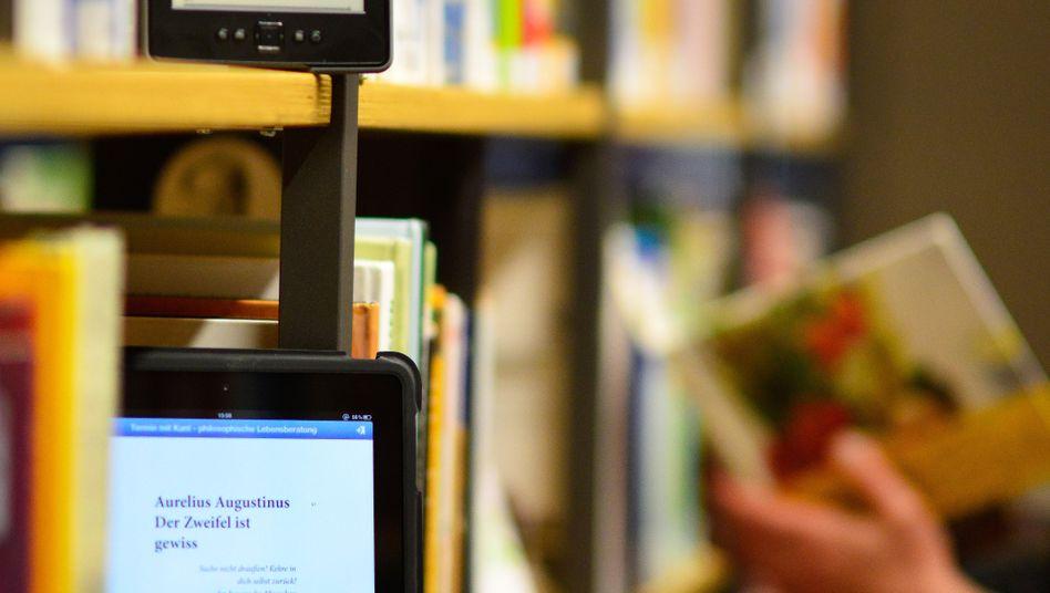 E-Reader im Bücherregal: Nichts mehr mit Knappheit verwalten