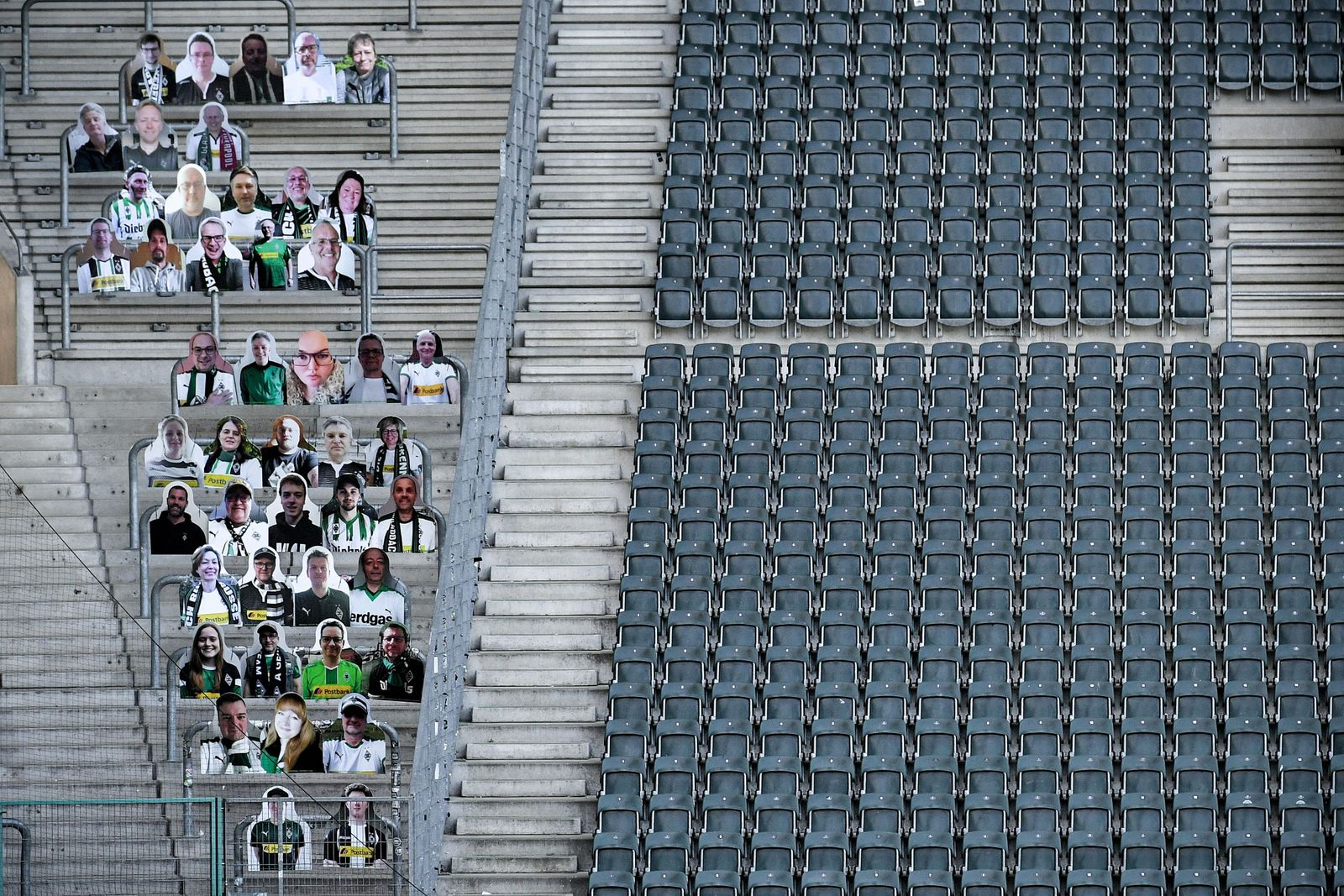 Cardboard cutouts replace supporters at empty soccer stadium in Germany, Moenchengladbach - 16 Apr 2020